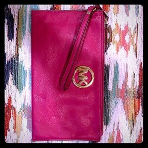 Pink Micheal Kors envelope clutch